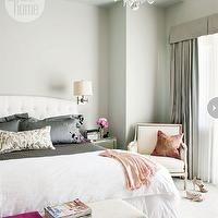 Style at Home - bedrooms - white headboard, white tufted headboard, white button tufted headboard, white diamond button tufted headboard, white duvet, hot pink throw, upholstered bench, wall to wall carpet, ivory carpet, adjustable wall sconce, brushed nickel adjustable wall scones, gray green walls, oversized glass and crystal chandelier, vaulted ceiling, gray green drapes, gray green curtain, pleated valance, gray drapes, gray curtains, gray silk pillows, mirrored nightstand, bergere ...