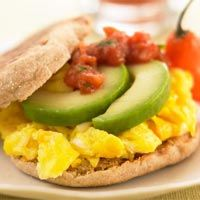 Egg, avocado, and salsa on an english muffin