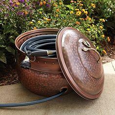 Garden Hose Storage Pot with Lid, http://www.amazon.com/dp/B0013EPG1U/ref=cm_sw_r_pi_awdm_Zcb-wb0YY4EPK