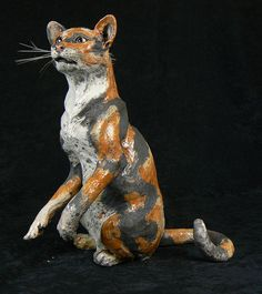 tortie  raku sculpture of siamese cat, grey and white cat, spitting cat, silver tabby and tortoishell cat by Lesley D McKenzie - Scottish Ceramic Artist