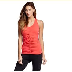 Lucy perfect core tank top NWOT Perfect core athletic tank top. Built in bra. Coral color Lucy Tops Tank Tops