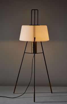 For Sale on - Floor lamp by Stilnovo. Manufactured in Italy, circa Brushed satin glass diffuser, enameled metal tripod base, brass hardware. Lamp Design, Lighting Design, Light My Fire, Glass Diffuser, Vintage Lamps, Tripod Lamp, Brass Hardware, Floor Lamp, Table Lamp