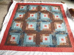 Darling Jill Quilts: Quilt #51 - Log Cabin     I'm not such a fan of the brown & red together.
