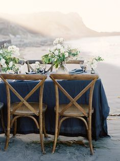 Refined beauty at the seaside | cross back dining chairs | navy blue tablecloth