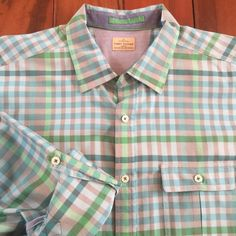 Tommy Bahama Men's Button Down Shirt Tommy Bahama Men's Button down shirt. Roll tab sleeve to wear shorter. 100% cotton. Worn one time, looks brand new. Tommy Bahama Tops Button Down Shirts