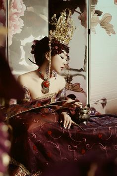 #2 Shoots based on extravagant shoots like this?  Cultural appropriation, White female model wearing garments that - make use of loud and bright reds with copious amounts of green and gold/yellow jewellery. Usually associated with the colours of luck and fending off bad luck (demons) as well as wealthy and beautiful women in the 16/17th Century.