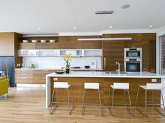 Lovely Italian Kitchen Design with Chic and Cool Design: Striking Yellow Flower For Modern Kitchen Interior With Brown Wooden Kitchen Furniture And White Countertop Combined With Italian Kitchen Design Ideas Natural Decoration