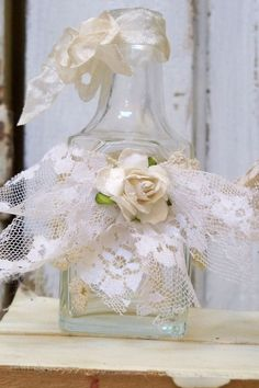 Shabby chic lace bottle-  add lace to anything, plus a rose for shabby chic look