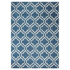 Anchor your living room seating group or define space in the den with this artfully hand-tufted wool rug, showcasing a quatrefoil trellis motif for eye-catch...