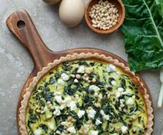 A savory Swiss chard tart inspired by the classic French tourte de blettes studded with toasted pine nuts and currants. #glutenfree #paleofriendly #primal