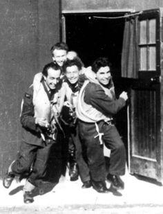 Czechoslovak RAF pilots Vaclav Truhlar, Vladimir Michalek,, Frantisek Bonish and Frantisek Fajtl (left to right) running to their planes. Airfield Hornchurch, near London. Václav Truhlář, Vladimír Michálek, František Bönish a František Fajtl (zleva doprava) vybíhají ke svým letadlům. Letiště Hornchurch nedaleko Londýna, leden 1942.