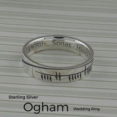 Ogham Sonas Wedding Ring.  Ogham is the ancient Irish alphabet. Ogham Sonas is Gaelic for Happiness.  Inside of band is engraved with the word Happiness in English. Available in Silver & Gold. Whole and half sizes from 4 to 13.  Choice of Width 5.2 mm or 7.2 mm.  Comfort fit. Handmade in Ireland by Boru.