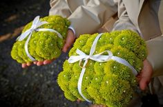 Ring Bearers. Small flower balls, also called pomanders, or delicate posies arranged in a willow or satin basket are popular for the little ones.  Eight or nine year old flower girls often like  to carry a small bouquet. Head wreaths, made with delicate blossoms and berries  are always a sweet touch.    A small boutonnier is perfect for the ring bearer ; he can also carry a pillow made with small flowers or moss-