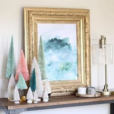 Eeeek I just love Holiday Home Tour season! This beautiful photo and styling is from my sweet friend @paigeknudsen. That's the LL Pine on Snow Abstract Canvas (with some sort of elaborate frame situation Paige conjured up) and a sweet grouping of pastel trees from @anthropologie and @starprovisions. I love it, Paige! #holidayhousewalk2015