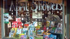 April Showers display at Annie Bloom's Books. The books featured all have activities and ideas for what to do indoors when it is raining. Raindrop chains are made from book pages.