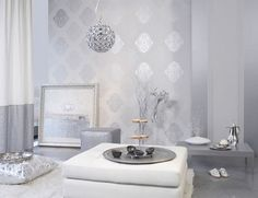 Too white for my family...but I would love the silver wallpaper on my fireplace wall!