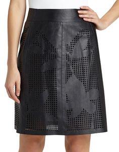 """<ul> <li>Cutout details with a floral motif add flair to this sleek style</li>  <li>Banded waist</li>  <li>Cutout details</li>  <li>Back zipper</li>  <li>Fully lined</li>  <li>About 22"""" from natural waist</li>  <li>Lambskin leather</li>  <li>Dry clean by leather specialist</li>  <li>Imported</li> </ul>"""