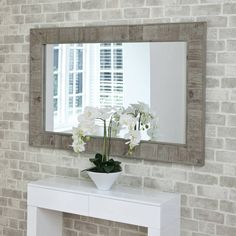 """This a great reclaimed wooden mirror. For long ways in stairwell. £248. Each mirror is a unique piece, due to the wood used. Please look at the detailed photography to get a full appreciation of the impact of this mirror.Reclaimed wood frame. 4mm mirror glass.90cm x 140cm (35"""" x 55"""")"""