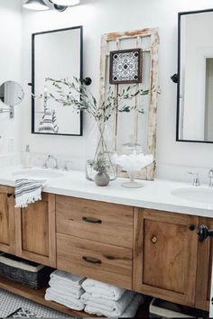 This gorgeous wood vanity from @homesweetfarmhouse gives the perfect rustic-yet-modern look to this bathroom. Shop the wall mirrors from Bellacor with the link.