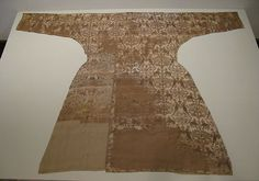 Coat,  11th–12th century, probably Spain, possibly Eastern Iran. Silk; samite Dimensions: L. 68 7/8 in. (175 cm) W. across sleeves: 50 3/8 in. (128 cm) W. across skirt: 37 in. (94 cm)