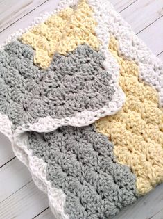 * Beautiful chunky crochet baby nursery afghan - makes a cherished pregnancy gift and receiving blanket! * This soft yellow, grey and white chunky baby blanket with a white scalloped edge is soothing and cheerful for baby! * Measures approximately 26 x 32. Great size for home- just right