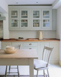 Farrow & Ball French Grey painted based cabinets and glazed cabinets. Serene and calm feel.