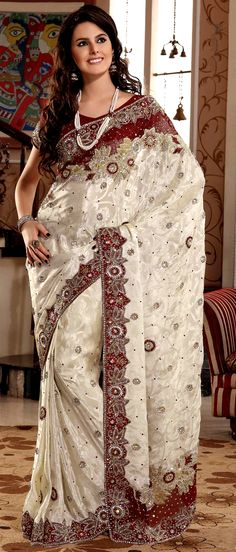 White Jacquard Saree With Blouse @ $317.64 | Shop Here: http://www.utsavfashion.com/store/sarees-large.aspx?icode=sma2200