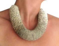 Necklace made from discarded books by Malena Valcarcel