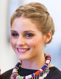 This hairstyle can be created by parting hair down the center and starting two French braids on both sides of the head. Once the braids have reached the back of the head, hair can be gathered into a low chignon.