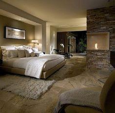 Fireplace in wall. Cozy bedroom