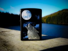 Howl at the moon with this Black Matte windproof lighter. Color imaging is used to create a misty full moon in the night sky, while an attached emblem completes the design with a textured wolf protruding from the lighter. Comes packaged in an environmentally friendly gift box. For optimal performance, use with Zippo premium lighter fluid.