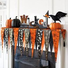 Slip the Bewitching Mantel Scarf over the shelf of your mantel, then top it with your favorite Halloween decorations and create an unforgettable display. Layered, pennant-shaped composition is made fr (Halloween Table Arrangements) Porche Halloween, Casa Halloween, Halloween Mantel, Theme Halloween, Halloween Home Decor, Holidays Halloween, Halloween Treats, Halloween Table, Halloween Bunting