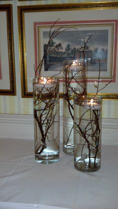 Romantic floating candles with wintry branches designed by Fleur de Vie.
