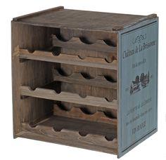 Stojak- półka na butelki wina. Wykonany z postarzanego drewna. W kolorze szarym i brudno-niebieskim. Pomieści 12 butelek wina. Produkt funkcjonalny i jednocześnie dekoracja wnętrza....