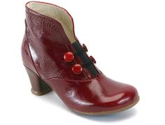 "Already a Fluevog classic, this 2.5"" heeled bootie with soft Baccarat Patent leathers, soft rubber soles, and a leather wrapped heel has won the hearts of millions of Fluevogers around the world. With a wide toe box, cute buttons, and a comfortable sole, this functional bootie promises to be the love of your life"