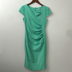 Mint Dress Assymetrical collar. Ruched bodice. Knee length/midi. Cap sleeve. Zippered back closure. Some thread has come loose on each sleeve(pictured), but it doesn't affect the integrity of the dress. Super stretchy fabric. Fits size 4-6. Celine Dresses Midi
