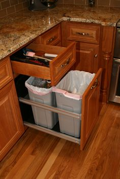 Double 35qt. pull-out garbage can- this is nice.  One for garbage,  the other for recycling
