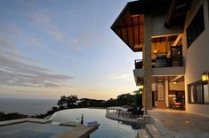 peaceful scenery, captures a relaxing essence, beautiful infinity pool, amazing illumination, creative way in setting up the house and balcony
