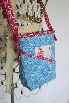I like the slanted pocket.  Also, is the little birdie print square a pocket too? Maybe! - - - Tag Along Tote by Atkinson Designs