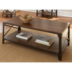 With glides to protect your floors and a durable rustic iron frame, the Windham coffee table is as practical as it is stylish. This beautiful rustic piece features a rustic, rich brown bottom shelf and top, with a dark brown X-accented frame.
