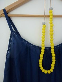Yellow beads on navy dress