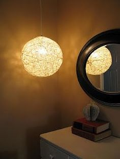 A great tutorial on making decoupage balls using yarn and balloons. This one is then used as a light fixture!