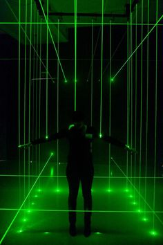 Laser Cage. Installation by Li Hui.  the visitor is temporarily and randomly surrounded by a cage made of laser beams. Hui uses the cage, which encloses but does not harm the visitor, to explore individual boundaries and demonstrate how people are influenced by purely optical – though physically irrelevant – barriers. https://www.youtube.com/watch?v=uu4UcLuct3w