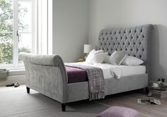 Lovingly handmade in the UK the Oxford Sleigh bed takes it's inspiration from classical Chesterfield inspired design. An elegant design that is sure to stand the test of time the Oxford bed has gentle curves and subtle design details that make this bed so distinctive. Available in a choice of 7 beautiful colours you're sure to be delighted with our new sleigh bed. The bed comes with a sprung slatted base for added comfort and support. Should you require any fabric sample please feel co...