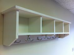 Entryway Shelf with Cubbies and Coat Hooks Handmade Solid Wood Coat Rack Hanger Cubby Storage Entry Organizer by KennedyWoodworking on Etsy https://www.etsy.com/listing/168515070/entryway-shelf-with-cubbies-and-coat