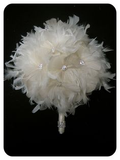 They likely used a chandelle feather boa to create this bouquet!