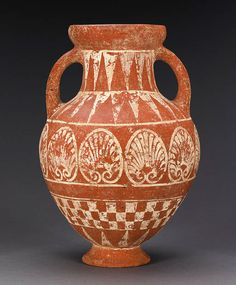 AN ETRUSCAN POTTERY AMPHORA   circa 650 b.c.   Red slipped, decorated in applied white, the neck and shoulders with descending rays, the body with a large band of palmettes, a band of checkerboard below, with rays above the foot  15 in. (40 cm) high