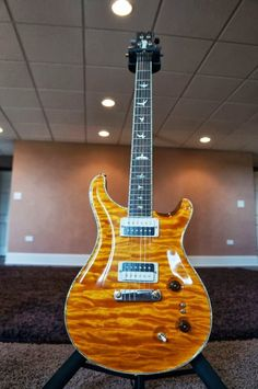 Here is a FANTASTIC 2013 INTERNATIONAL Brazilian PRS Private Stock...I will ship this Internationally, but you have to call and get a quote!!This guitar is USED, but a solid 9.8/10 and all the woods and specs were selected by a VERY REPUTABLE PRS Customer from the Private Stock Vault at PRS.Features Include a McCarty body with Signature Electronics.International Brazilian Rosewood Neck, Fretboard, and Headstock (RARE)Zebra 57/08s (RARE)Paua Purfling around perimeter of Body!Mother of Pearl…