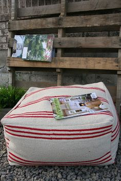 Make your own floor poufs out of cheap Ikea rugs