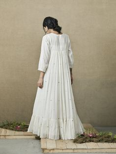Product Code: of our most loved designs, Wind Whispers Maxi Dress is a perfect vacation staple with ditzy hearts, delicate details and tiers below the hem. Made in rich handwoven Jamdani cotton, It come with a lace slip dress. Cotton Dress Indian, Indian Dresses, White Maxi Dresses, Simple Dresses, Summer Dresses, Simple Kurta Designs, Indian Designer Outfits, Different Dresses, Lace Slip